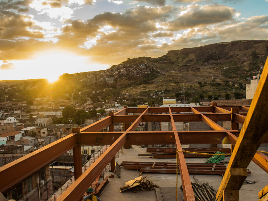 Sunrise over social impact affordable housing construction project in Latin America