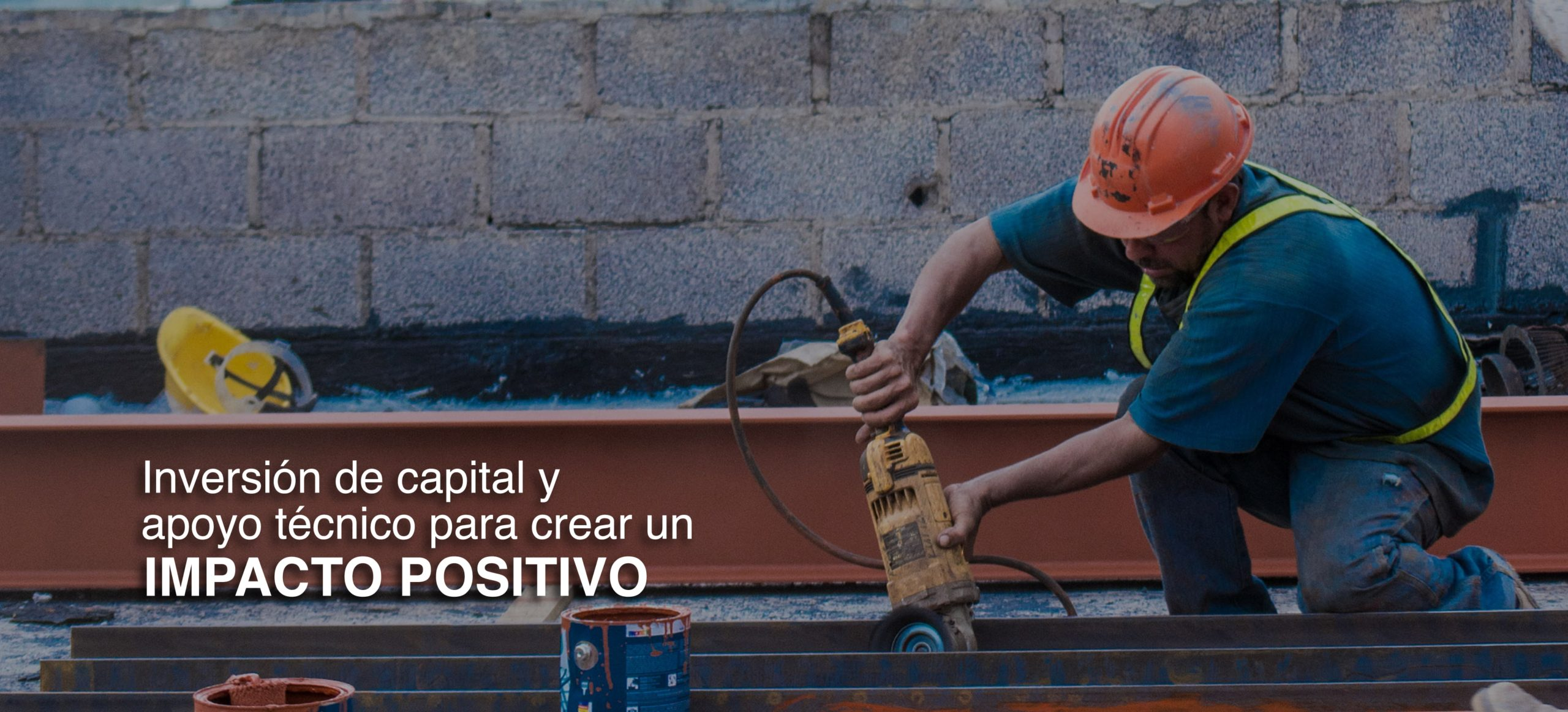 Social impact construction worker wearing safety equipment building affordable housing in Latin America